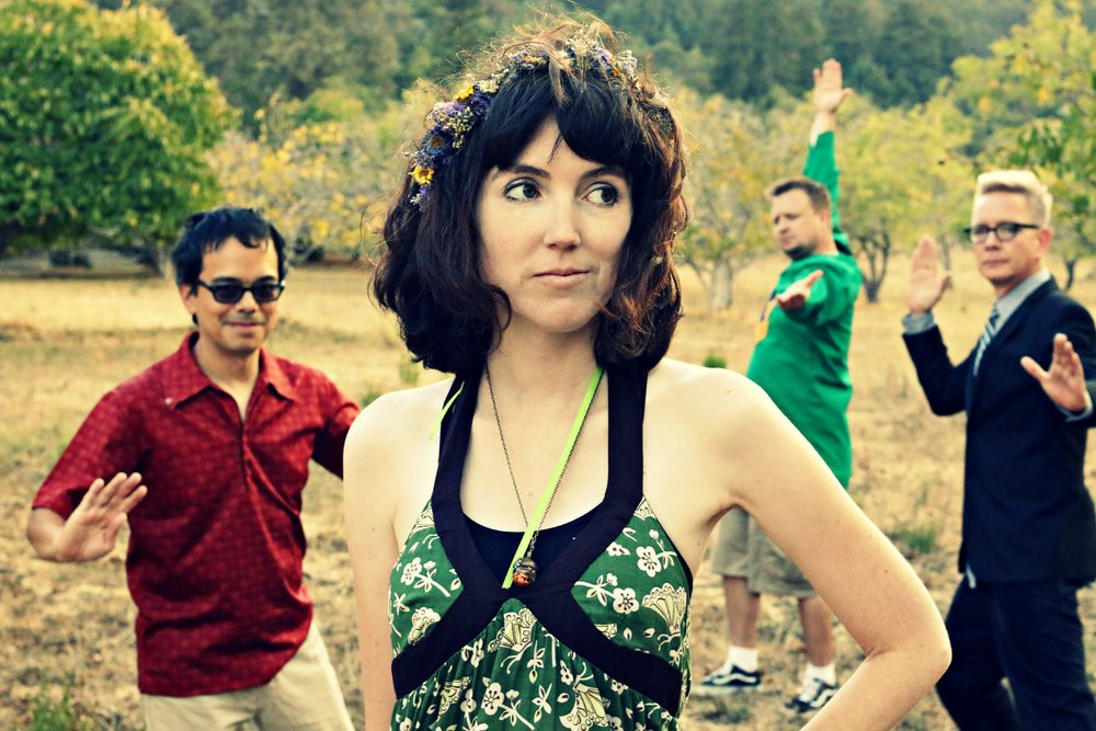 "Yes, lead singer/songwriter Karla Kane wears cat-eye glasses, plays ukulele and goes birdwatching, but The Corner Laughers are no stereotypical hipster-twee band.Kane's literate lyrics and ""ridiculously catchy"" melodies (Word Magazine) are backed up by the powerhouse combination of virtuoso guitarist KC Bowman and rhythm ninjas Khoi Huynh and Charlie Crabtree on bass and drums. And FYI, that ukulele is electric. An intriguing mixture of bookish and badass, together they create ""rousing, visionary adult pop"" (Tom Robinson's Fresh on the Net)."