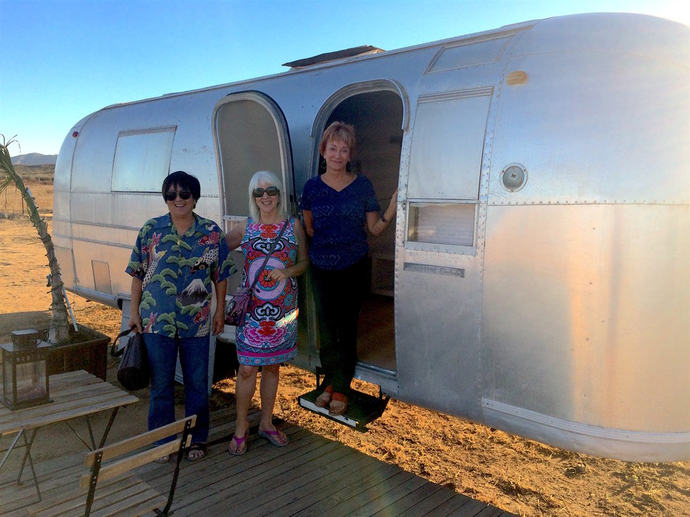 Karen (far left) with her friends on tour with BTK, exploring one of the Valle's unique lodging options.