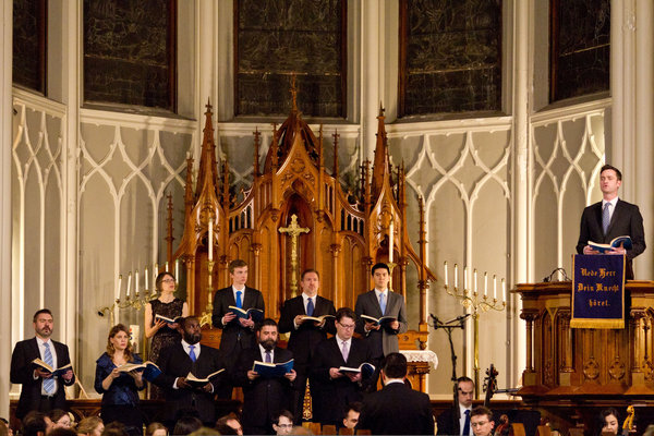 "The ensemble Tenet, with Aaron Sheehan at the pulpit, performing Bach's ""St. John Passion"" at the German Lutheran Church of St. Paul, in Chelsea."