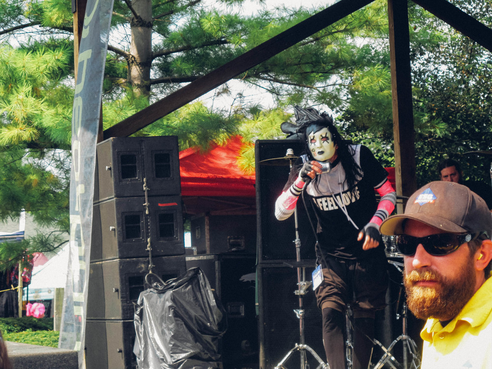 The lead singer of electro-punk duo Drama Club raps under his mask on a stage near the entrance of Klipsch.