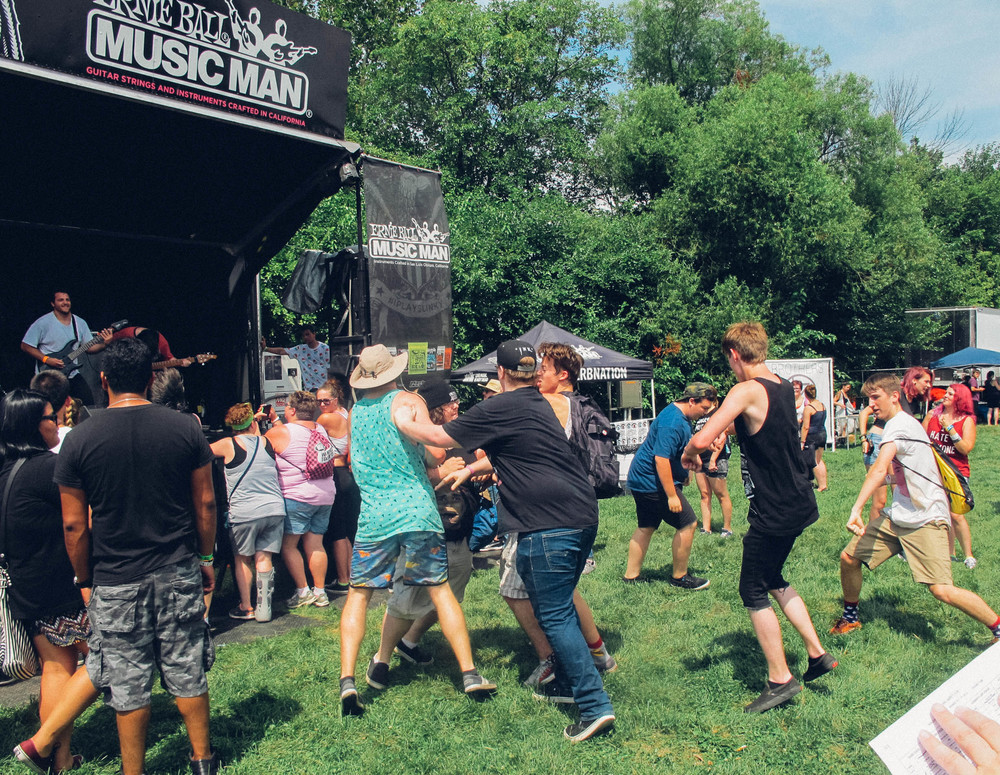 While moshing is prohibited at the bigger stages, some friendly shoving and punching is permitted during smaller sets.