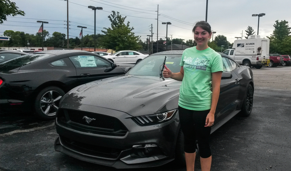 Tabby Branyan, contributor for The Campus Citizen,getting ready to test drive the 2015 Mustang 4 cylinder 310 horsepower with the Ecoboost engine.