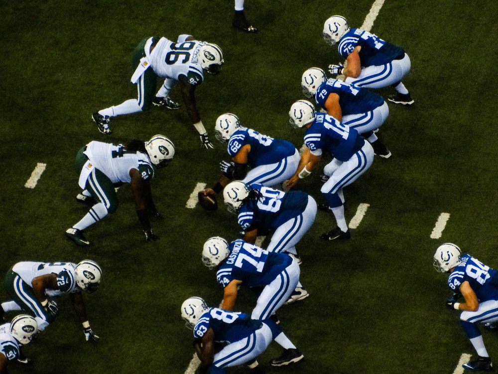 Andrew Luck (12) and offensive line ready for the snap.