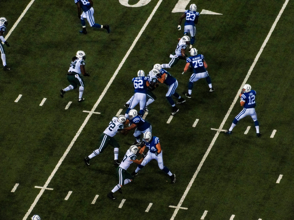 Andrew Luck (12) dropping back for the pass.