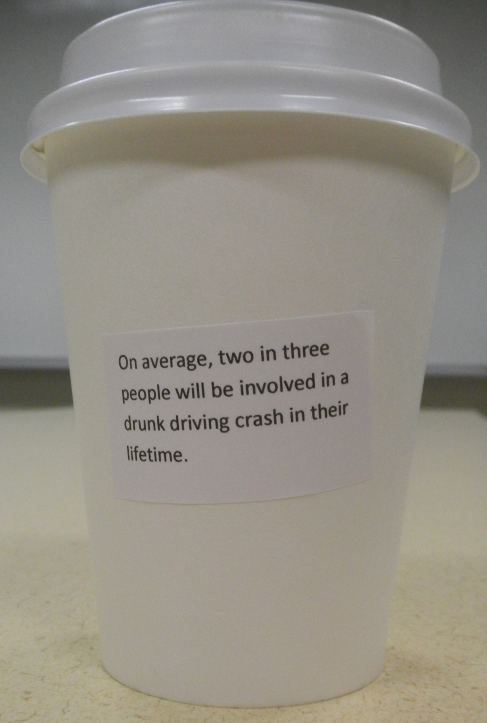 An informative sticker on the side of the cups used by Alpha Phi Sigma.