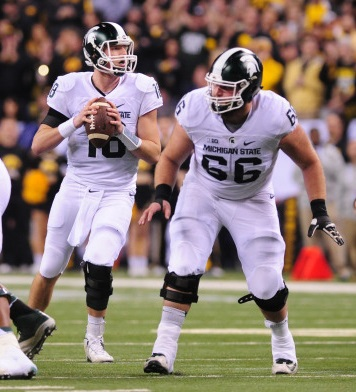 Michigan State center Jack Allen (66) looks to protect quarterback Connor Cook during the Big Ten Championship game on Dec. 5 in Indianapolis. (Photo courtesy Michigan State