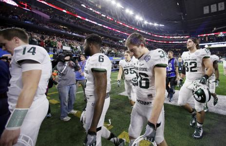 Michigan State players leave the field after the Cotton Bowl loss to Alabama on Dec. 31, in Arlington, Texas. Alabama won 38-0 to advance to the championship game. (AP Photo | Tony Gutierrez)