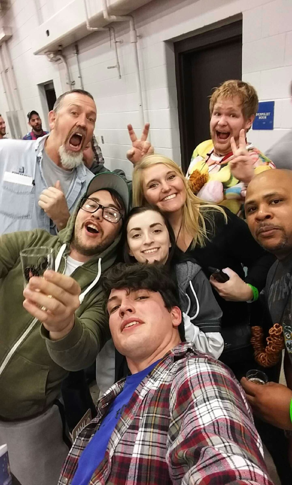 Keegan Rammel with old friends and some strangers at Winterfest