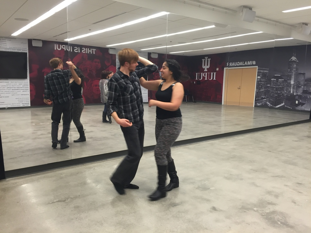 David Gurecki and Tania Gurdasani dance together during a Swing Cats practice.