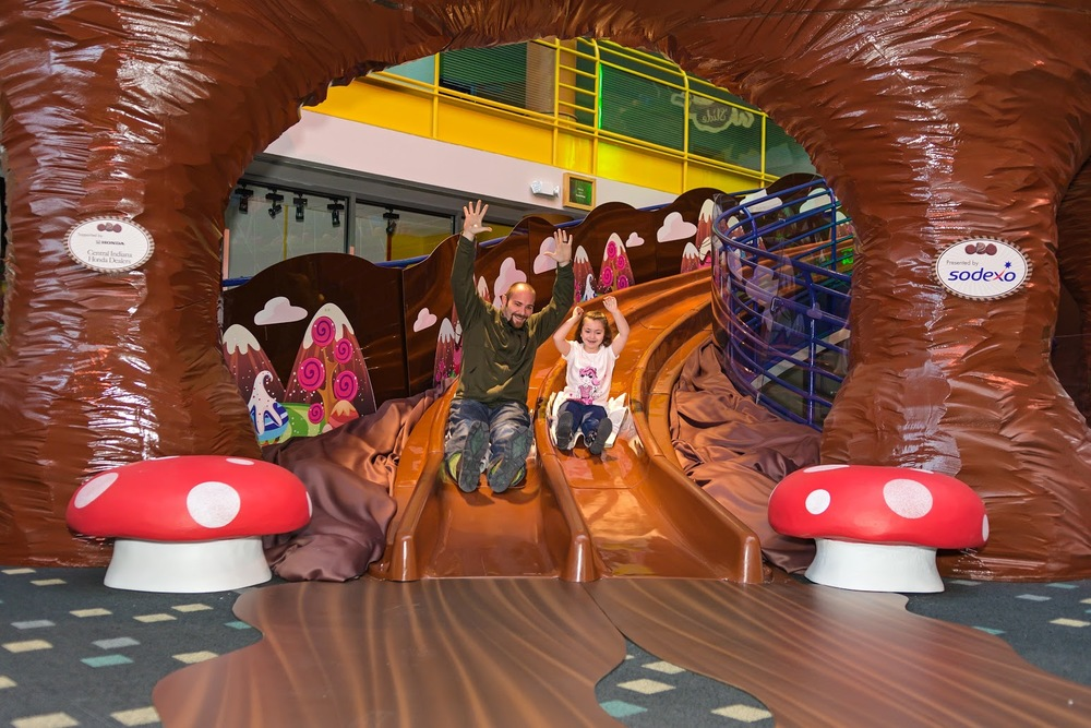 Visitors take a trip down the Children's Museum's chocolate slide, open through April 17 (photo courtesy of the Children's Museum)
