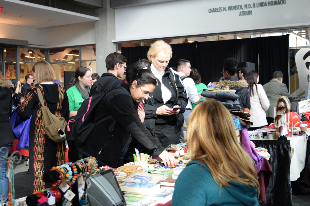 Visitors shopping at the Global Gifts booth.