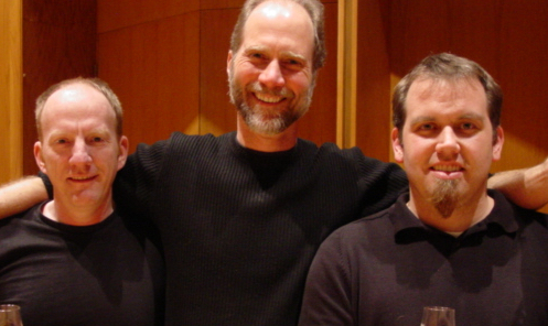 Scott Deal on the left, John Luther Adams in the middle, and Stuart Gerber on the right, pose together in 2004.