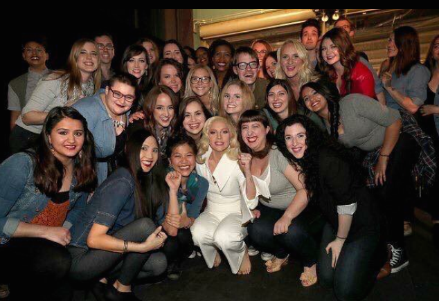 Survivors' pose together after Lady Gaga's performance at the Oscars.