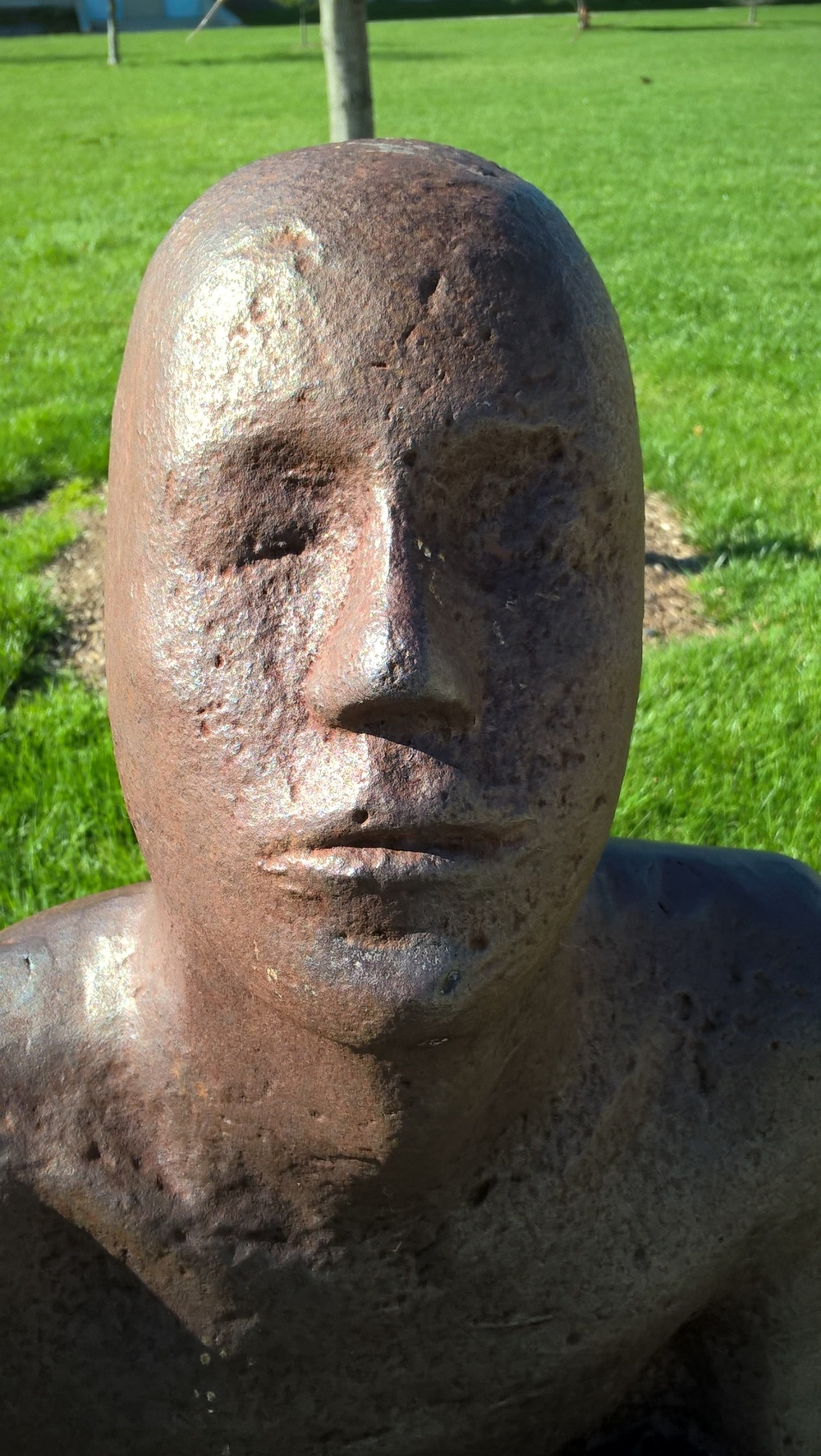 """A closer look at the face of one of the """"Horizons"""" figures."""