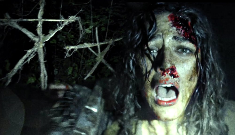 Lisa (Callie Hernandez) runs from the Blair Witch. (photo courtesy of Vertigo Entertainment.)