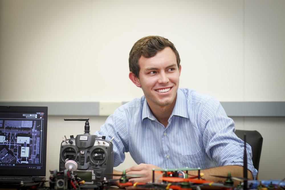 George Tipker with a handmade drone. (Photo by Keeley Miller)