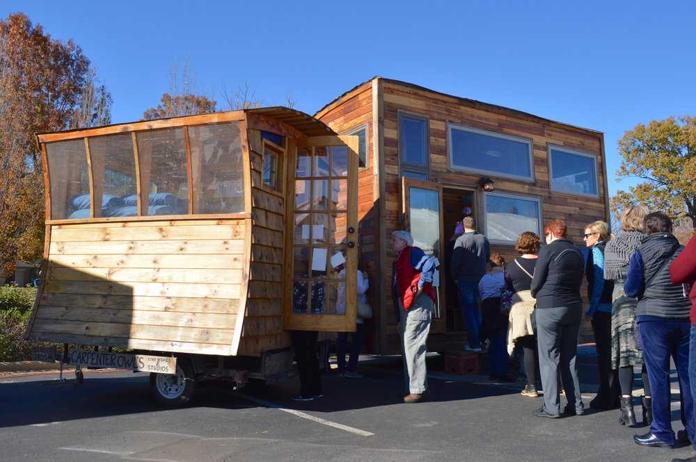 Crowd lined up to view tiny home.