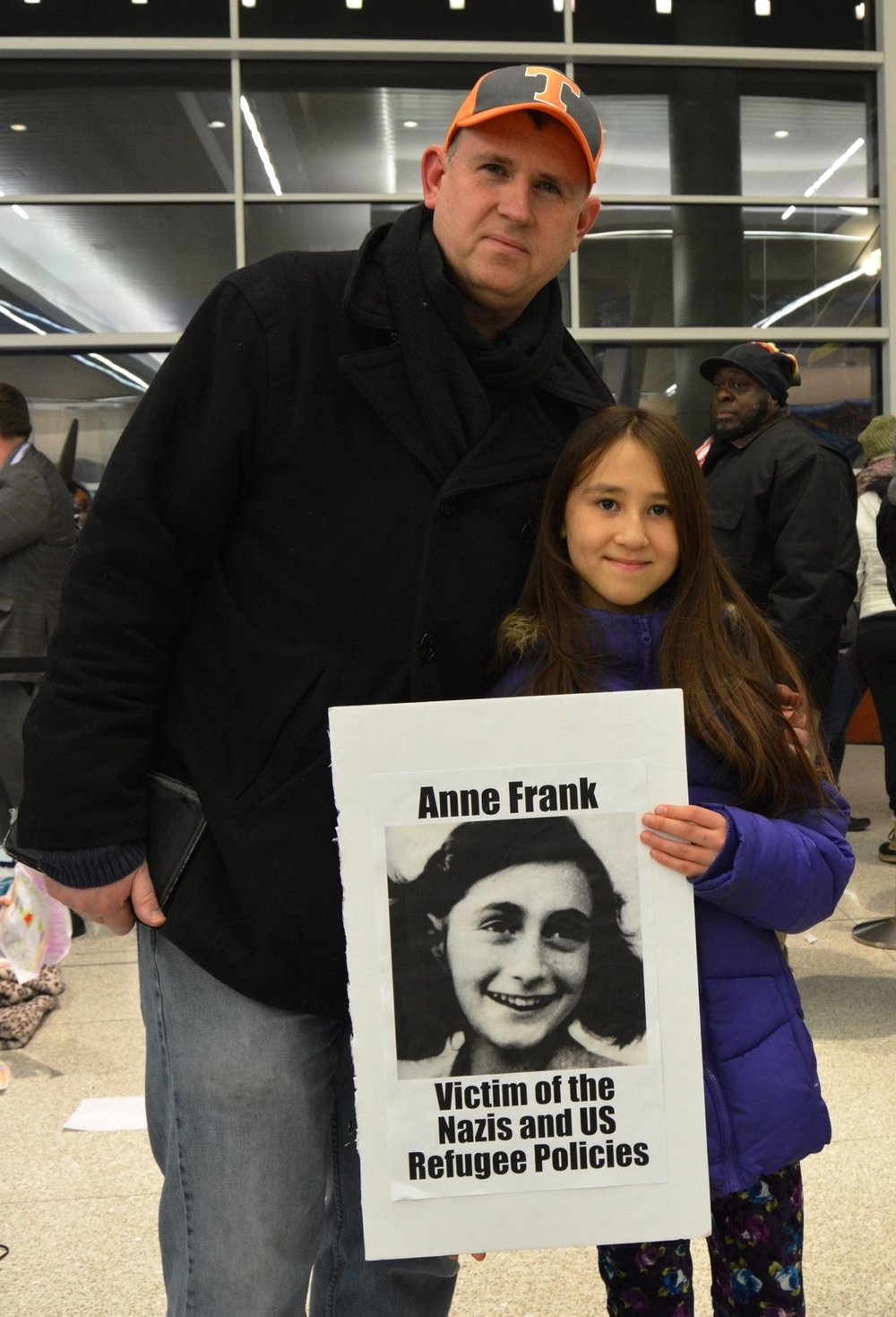 Brian Ruckle and his daughter Elena, 9, protest together at the Resist the List rally.