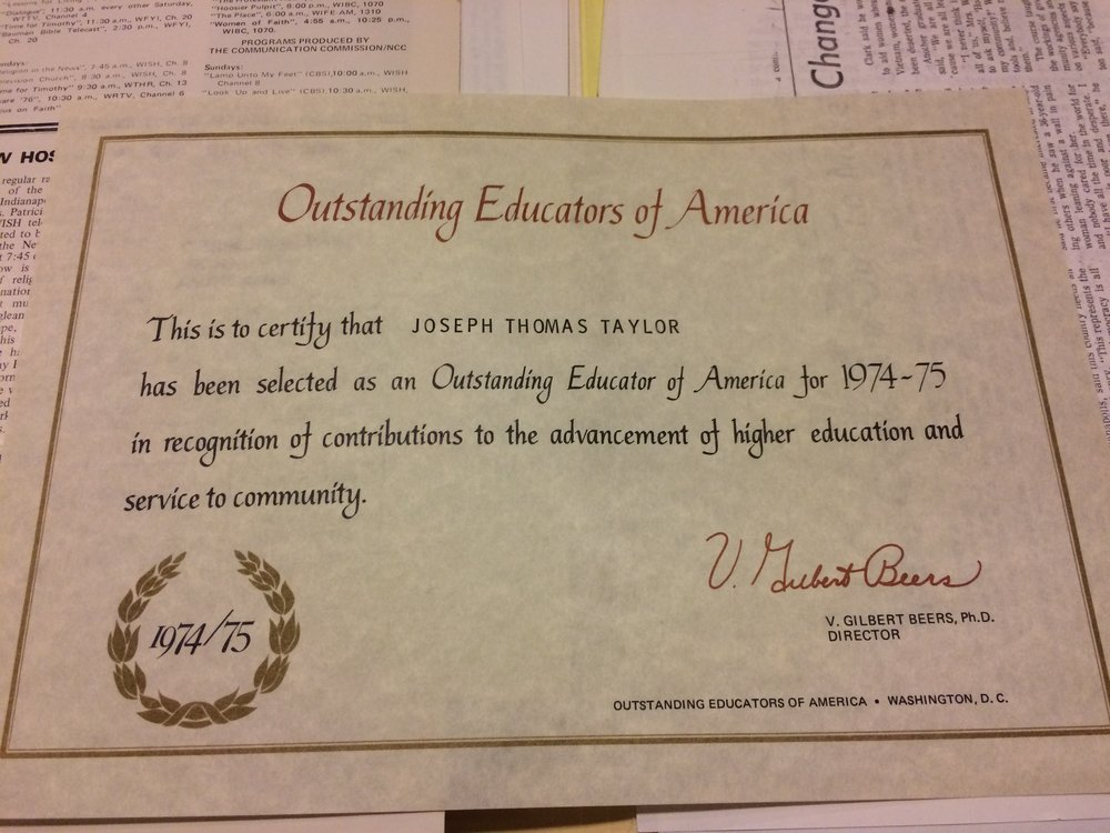 Certificate for Taylor in Outstanding Educators of America. Photo by Paris Garnier