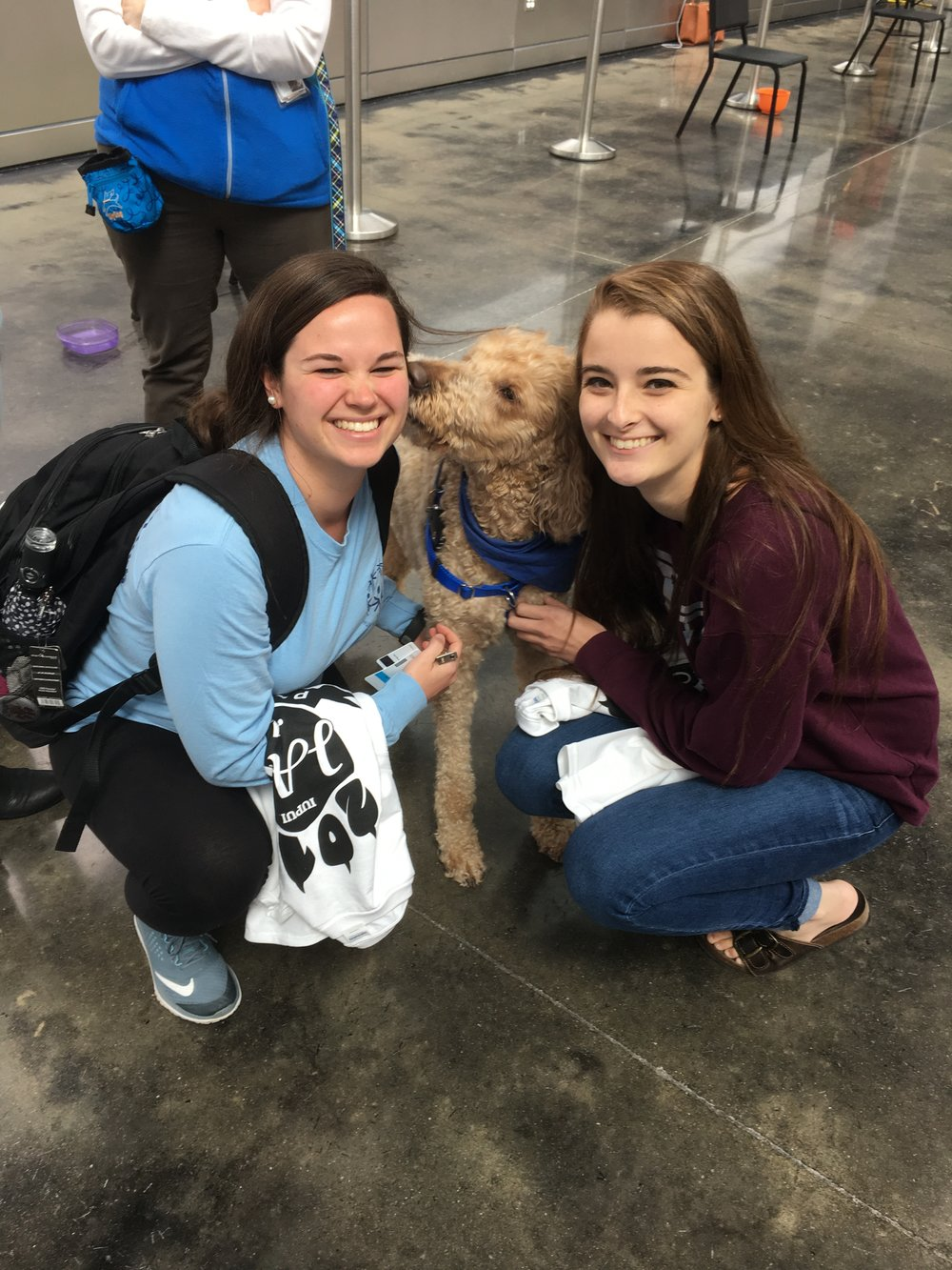 Photo of author with emotional support dog and another IUPUI student