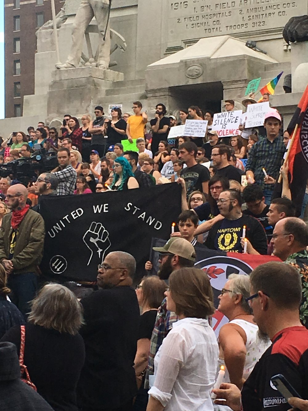 Demonstrators stand united on Monument Circle.