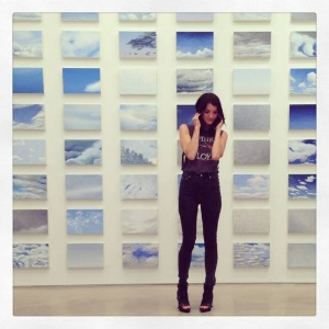 """Cynthia Daignault standing in front of """"Light Atlas."""" Photo from Lvl3"""