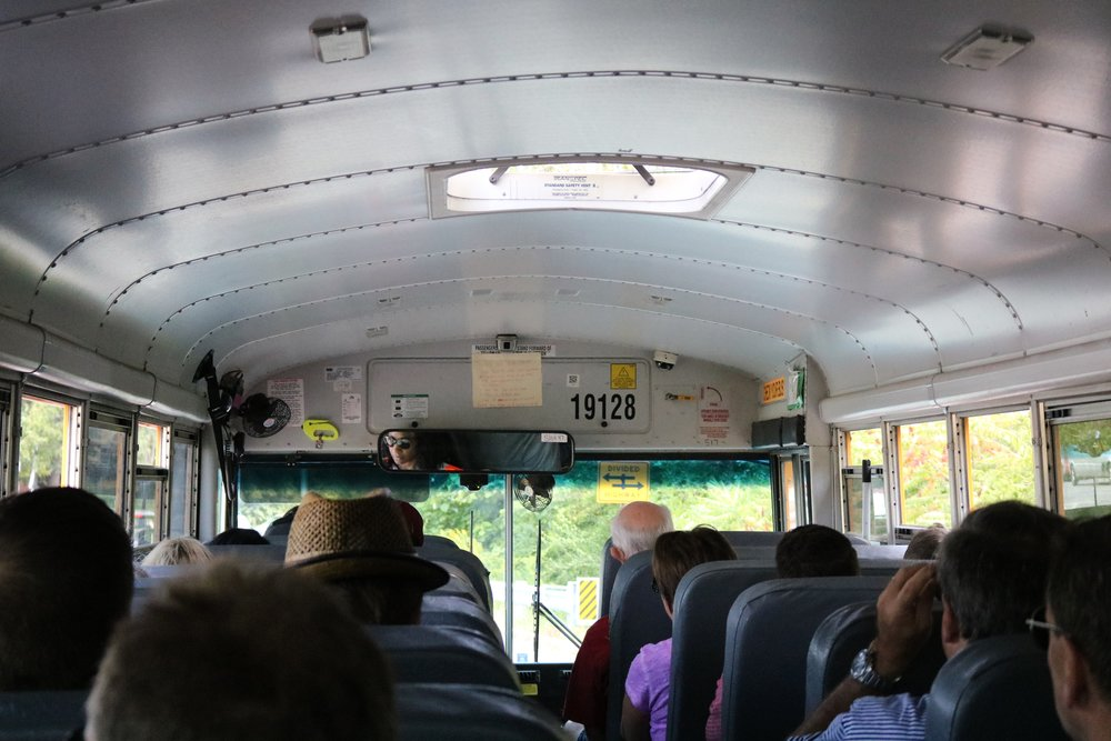 Penrod fair goers ride a school bus from the parking lot set up at the Indy Cycloplex to the Indianapolis Museum of Art.