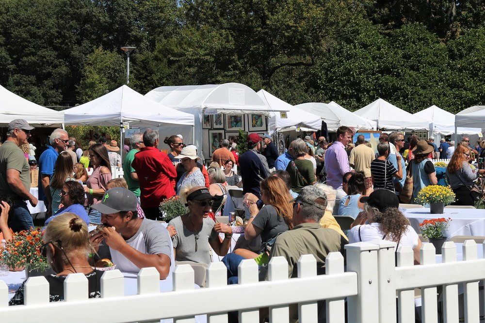 Penrod guests enjoy the rest area provided amidst the art tents.