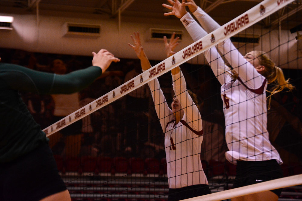 McKayla Wright and Haley Hoffman go for the block aginst Wright State in the second set.