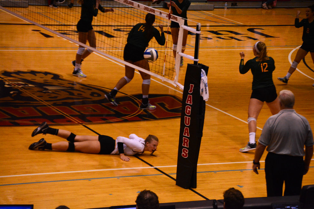 Kori Waelbroeck who lead the team in kills, dives in the third set.