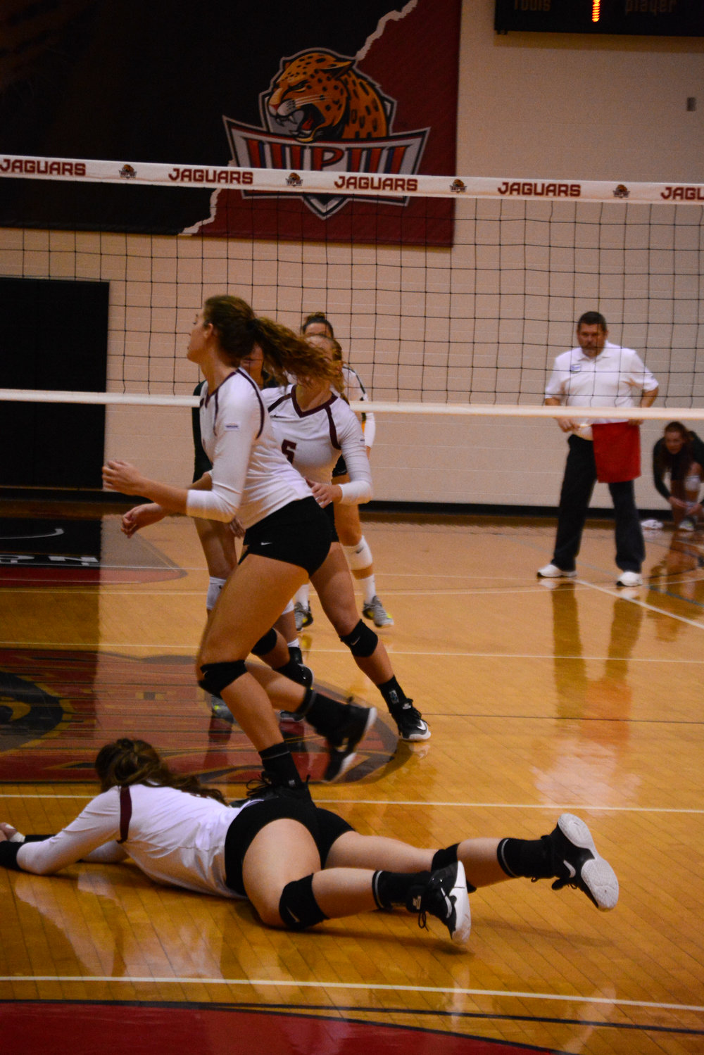 An IUPUI player saves the ball in the third set  of the match.
