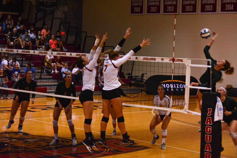 Abby Boatman and Kori Waelbroeck prepare for a block against Wright State.