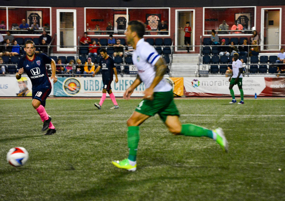 Ben Speas of the Indy Eleven goes after the ball after a Cosmos player began moving up the field. (Photos by Halley Best.)
