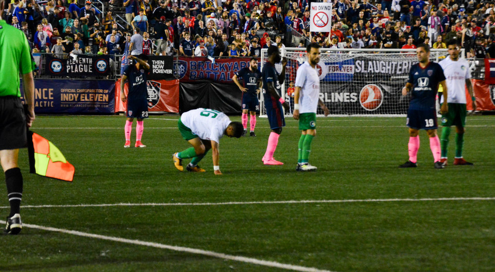 A New York Cosmos players gets up after a foul. The two teams conceded 28 fouls combined in the match.