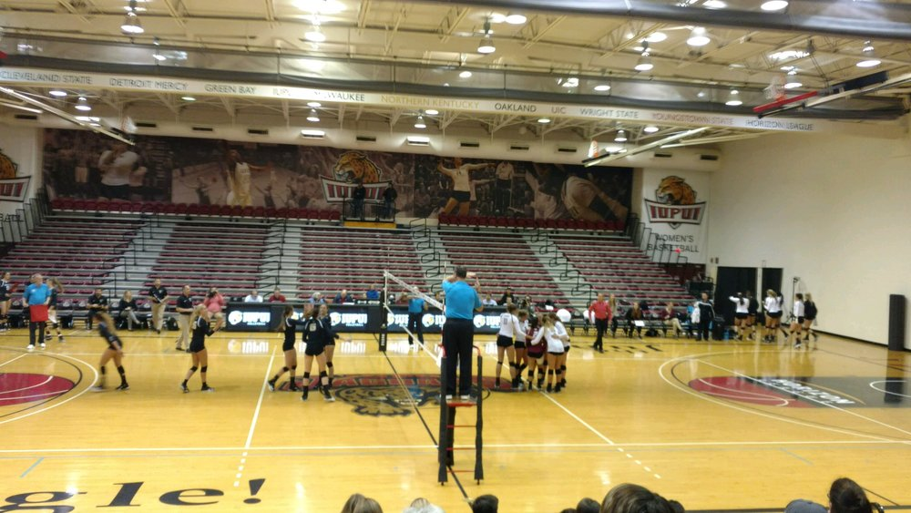 The Lady Jaguars huddle after recording a kill.