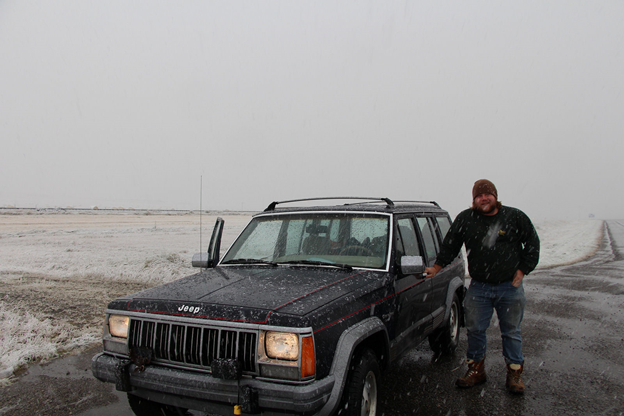 Outreach Assitant Adam Janzen enjoying a snowstorm in August 2015