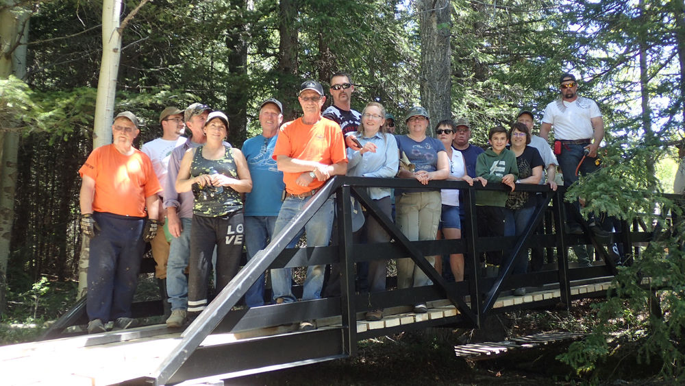 Volunteers from the Crowsnest Pass Quad Squad and the finished OHV Bridge