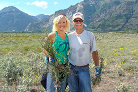 Father daughter weed pull, Norm Elford and Leta Pezderic, at Knapweed Rodeo in Waterton (Photo courtesy Leta Pezderic)