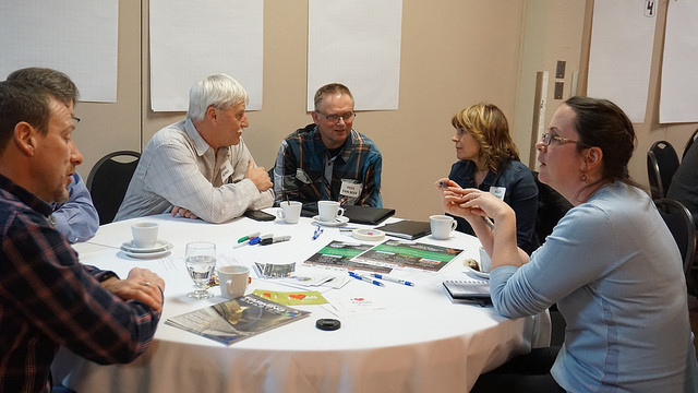 Participants discussing agricultural watershed stewardship at the Taber session.
