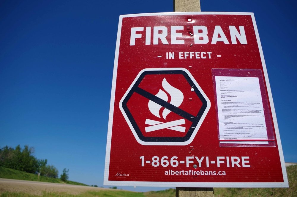"Fire Ban - The 'Fire Ban"" tells users that fires are completely banned from all random camping and designated fire pits. Only gas/propane stoves and fire pits are allowed. It's important to note that Crown land and Public Land Use Zones can vary in these rulings. The penalty for having open fires in these conditions include fines up to $25,000 and up to 12 months in prison. For more info check out: albertafirebans.ca"