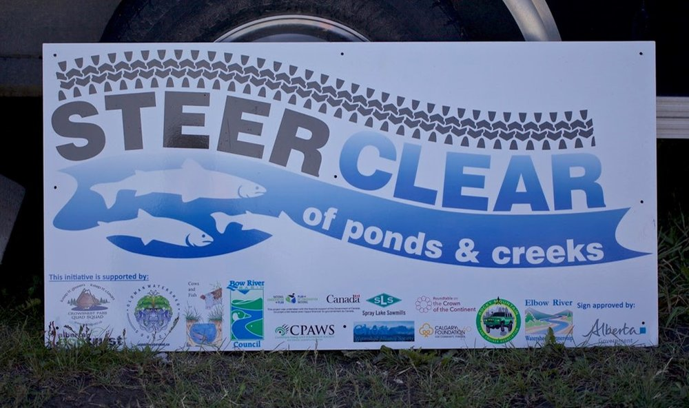 Steer Clear of ponds & creeks - 'Steer Clear' signs will be found at some river and creek crossings through the Oldman Watershed. These signs have been put in place as a visual reminder to hikers, bikers, quadders, dirt bikers, and all other backcountry users to use a bridge instead of fording the water.The silhouettes of Westslope Cutthroat Trout remind people that even the smallest habitat change can have detrimental effects on this threatened species. Steer clear and help to protect our fish! For more information on sedimentation in fish habitat check out this link.