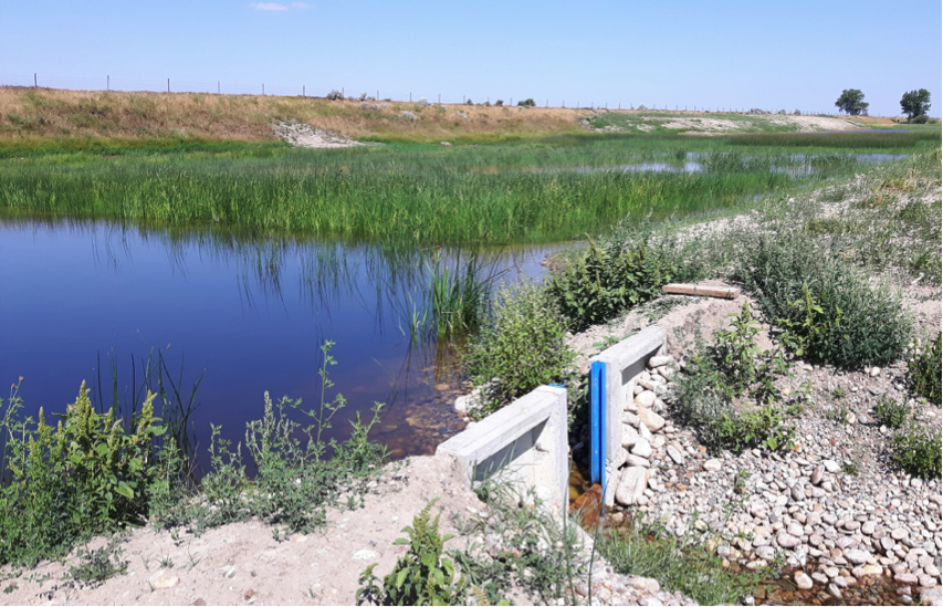 Outlet Structure Back into Taber Lake Lateral Looking NW