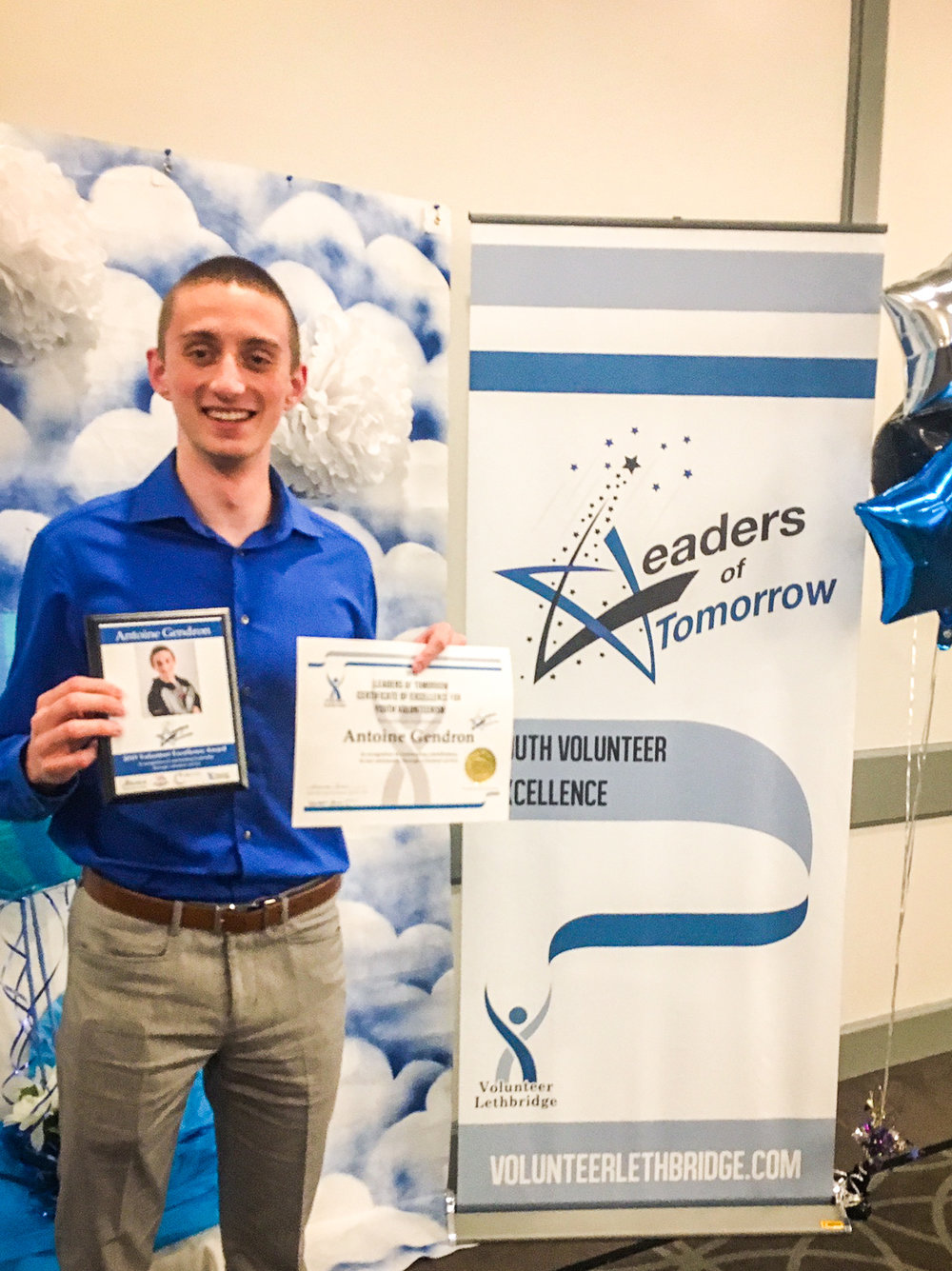 Antoine showing off his Excellence Award at the 22nd Annual Leaders of Tomorrow Gala in 2019.