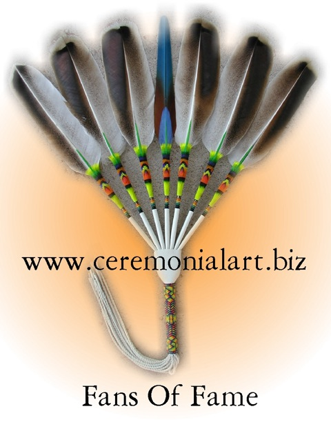 Alexandria feathers fan, side drop fan. This fan only opens toward the side, it does not drop like a round drop fan. This style is common among gourd dancers, nac people, and straight dancers.
