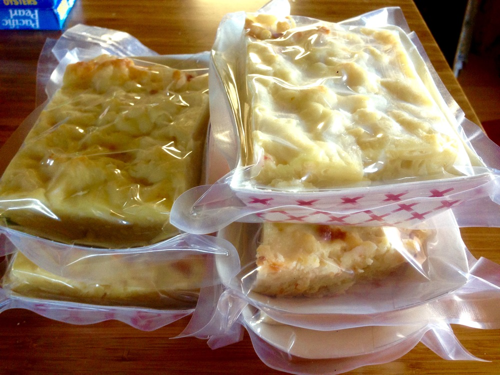 Packages of mac and cheese ready for the freezer.