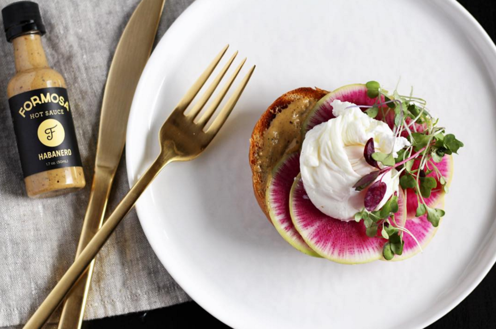 Poached Egg with Watermelon Radish, Microgreens and a touch of Formosa Hot Sauce (Photo courtesy Amanda Saab's Instagram)