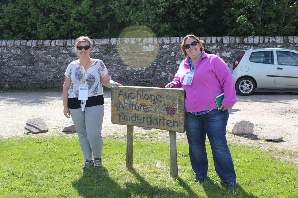 Clare Nugent and me in front of the welcome sign at Auchlone Nature Kindergarten in Crieff, Scotland.
