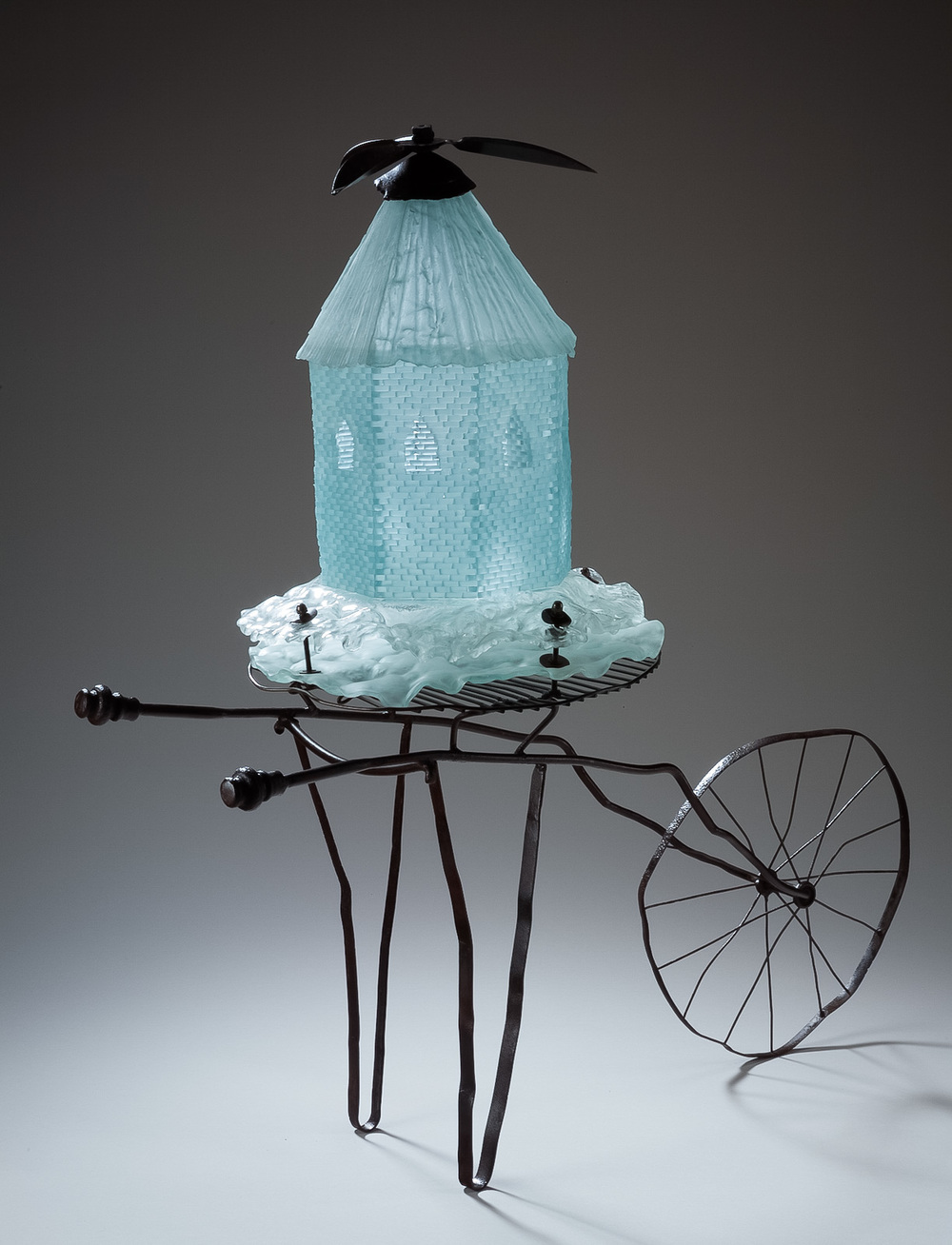 "Kenosis : migrations and immigrations Scrap metal and glass, 2008. 49"" h x 24"" w x 48""l  Individual sculptures made of recycled glass and metal related to immigration and migration"