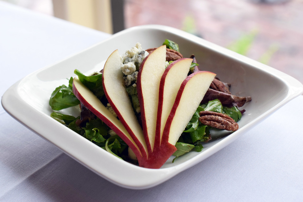 POACHED PEARS and DARK CHERRY BALSAMIC mixed greens, red wine poached pears, gorgonzola crumbles, dark cherry balsamic dressing, sugared pecans