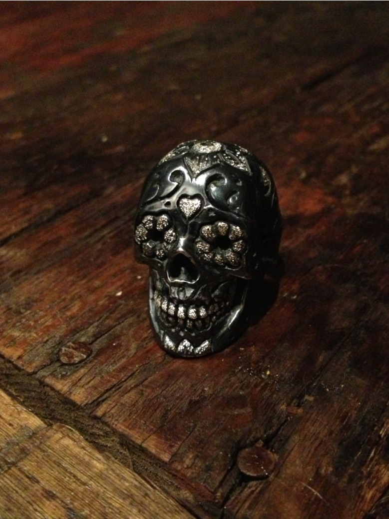 Sugar skull ring. I am considering setting 24k gold in the eyes.